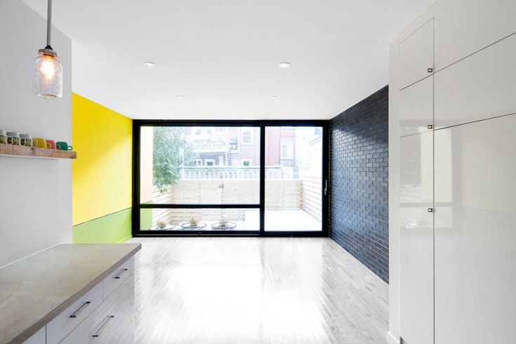 8th Ave. Residence by _naturehumaine.  The colour palette of the interior was kept subtle, with bright accents from the exterior facade.