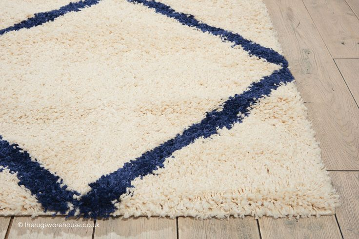 NEW IN: Brisbane Ivory Blue Rug (texture close up), a modern shaggy rug with a simple tribal diamonds pattern in ivory & blue (100% polypropylene, machine-woven, 2 sizes) http://www.therugswarehouse.co.uk/shaggy-rugs/brisbane-rugs/brisbane-ivory-blue-rug.html