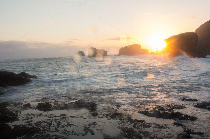 A rocky beach at the sunset by Farkas B. Szabina on @creativemarket