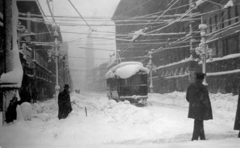 Colorado historic blizzards - #2 is the March 2003 blizzard.This photo, taken the morning of Dec. 6, 1913, during the great snowstorm of 1913 shows people trudging through snow at 16th Street and Welton Street. The City Tramway trolley car is hindered by the piles of snow in the street .