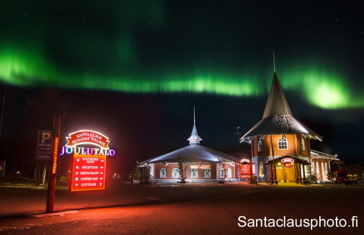 Santa Claus Holiday Village at the Arctic Circle in Lapland under Northern lights