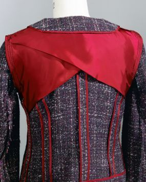 A half lining protects the fashion fabric from the wear and tear of upper back movement and prevents the shape of interior construction deta...