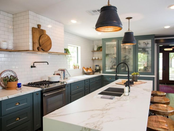 New additions in the kitchen include a farmhouse sink, marble countertops, new cabinets, recessed lighting and a custom island with waterfall edge. The doors on the newly added pantry have mercury glass inserts emulating the look of an antique mirror.