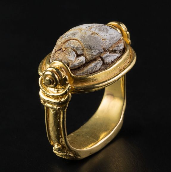 Gold Ring with Scarab from Old Egypt (2000 BC - 300 BC). A steatite scarab, nicely detailed, set in an 18-karat gold ring. Traditional design of ancient rings, reversible to be able to read the engraving on the scarab. This ring is a single edition made for an exclusive collection of hand-made jewelry, designed for the seller's gallery.