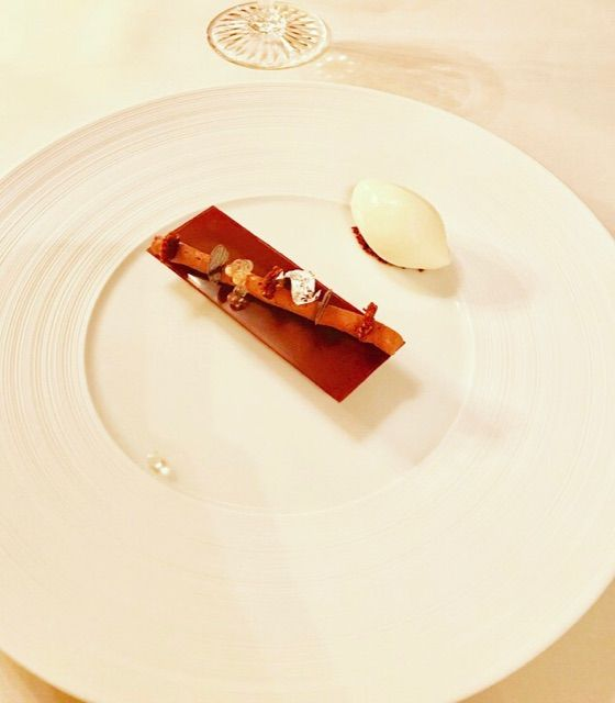 Exotic chocolate yozu dessert at three Michelin star restaurant Cheval Blanc in Basel, Switzerland