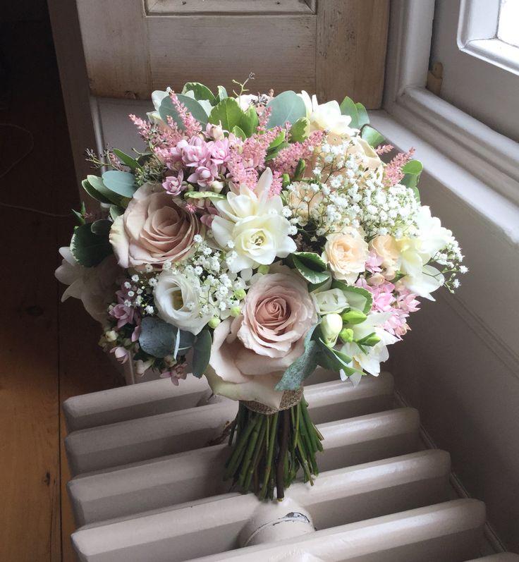 Quicksand roses , pale blush , dusky pinks , bouvardia , white freesia , lisiantha , grey foliages , wedding handtied brides bouquet tied with hessian ribbon