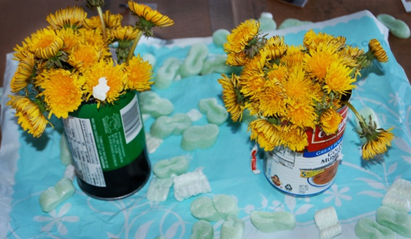 Dandelions in cans. Fabulously trashy.