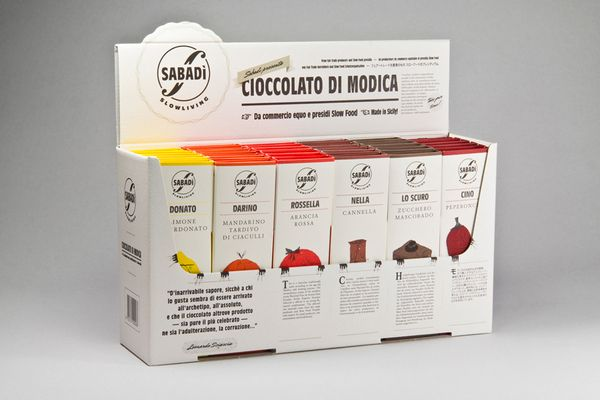 """Sabadì — Slow Living Modica Chocolate Sabadì is a brand that mainly focuses, since its birth, to eatables that have a magic inside. The first product that came out of this brand is a """"cioccolato di Modica"""", a typical sicilian way of making chocolate, in this case made by extraordinary cocoa selected in Ecuador, in six combinations with strong personality."""