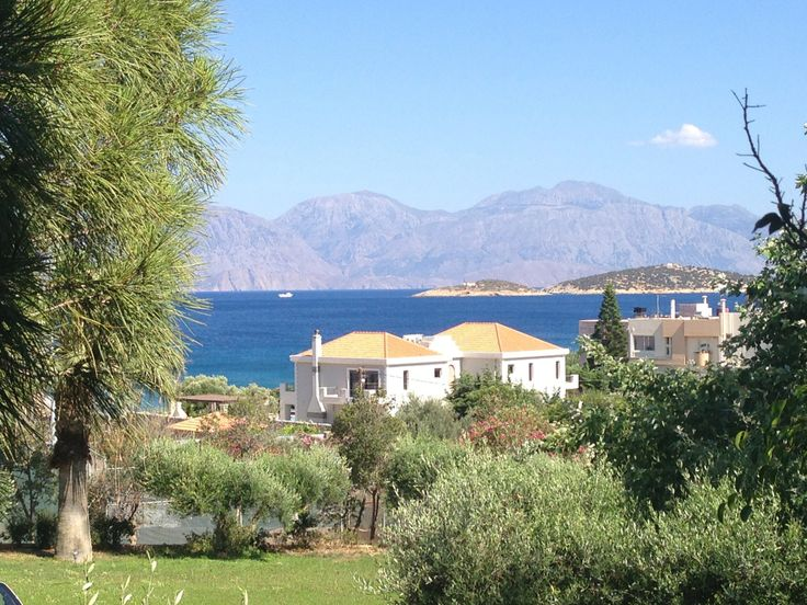 The extensive gardens blend in style with the picturesque Cretan environs.