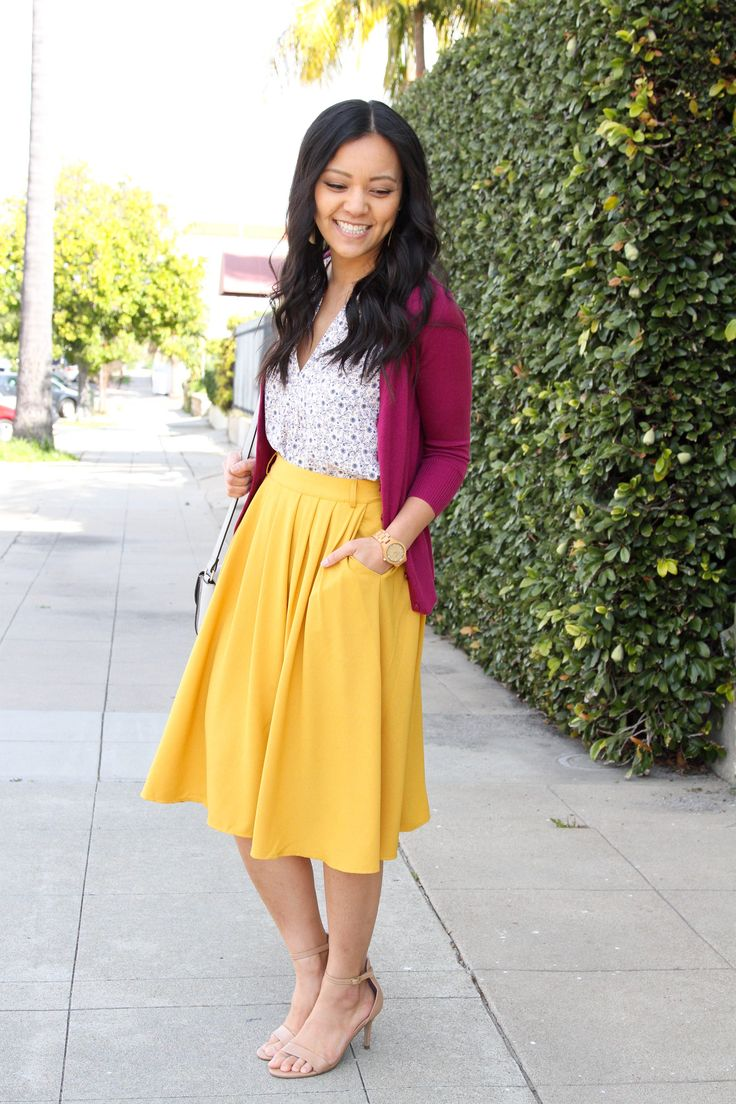 magenta cardigan + ankle strap sandals + White floral + yellow skirt +grey cross…