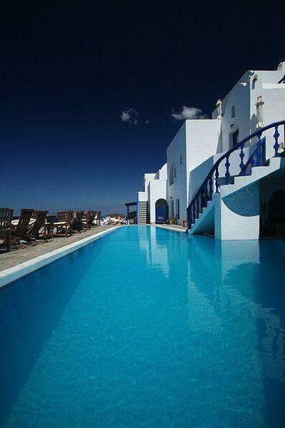 Thira - Santorini, Greece.  Beautiful pool!  ASPEN CREEK TRAVEL - karen@aspencreektravel.com