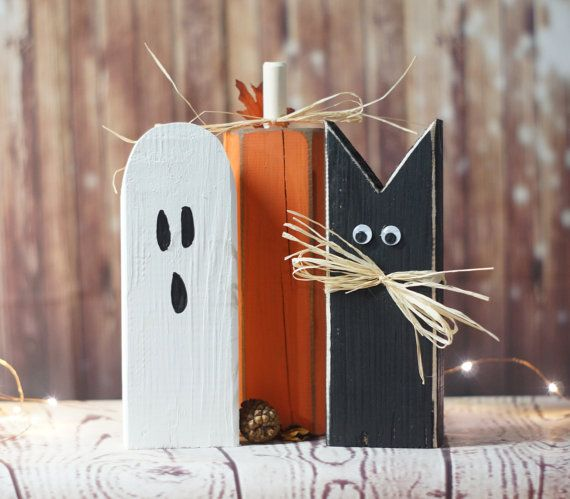 Reclaimed Wood Primitive Rustic Halloween Décor. Set of Three: (1) Painted Cast Iron Black Cat. Hand Distressed With Googley Eyes and Natural Rafia Bows. (1) Painted White Ghost with Black Hand Painted face (each one is different and face may vary, please convo if you would like a specific expression) (1) Painted Orange and Distressed Pumpkin, With Burlap bow and green covered floral wire. Display on Tabletop, Mantle or Porch. Approx. Size: 10-12 tall 3-4 wide Please note heights or each...