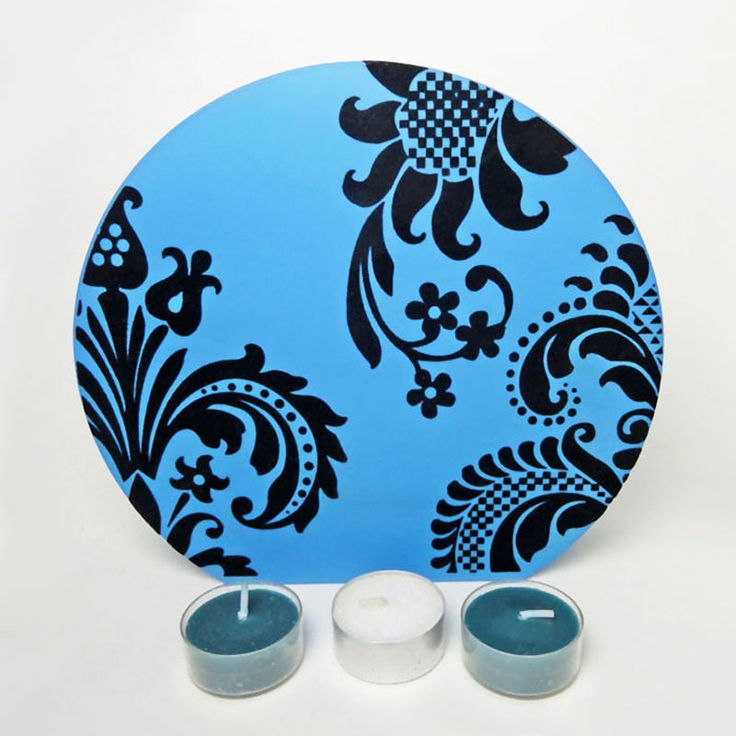 Blue Glass Round Top Tealight Candle Holder - CH247 - Blue frosty glass round top, flat botton, tealight candle holder with dark velvet swirls. Three tealight candles sits in a thick glass cup. Cups connects the two sides together. Beautiful home accent piece - in use or not. Uses no electricity. FOR SALE