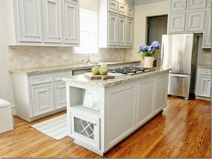 In the kitchen, the walls are painted Benjamin Moore's Baby Fawn, while the cabinets are Wickham Gray.