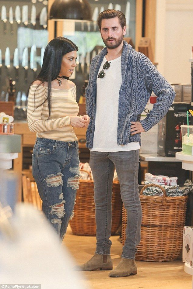 Sharp: Scott looked relaxed in a blue cardigan and grey jeans...