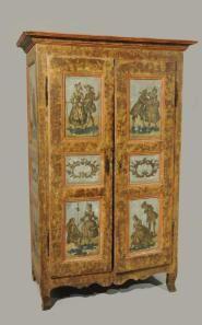 Armoire en bois fruitier mouluré, sculpté et estompé brun. Six panneaux en façade et trois sur les côtés à décor en arte povera de scènes ga...