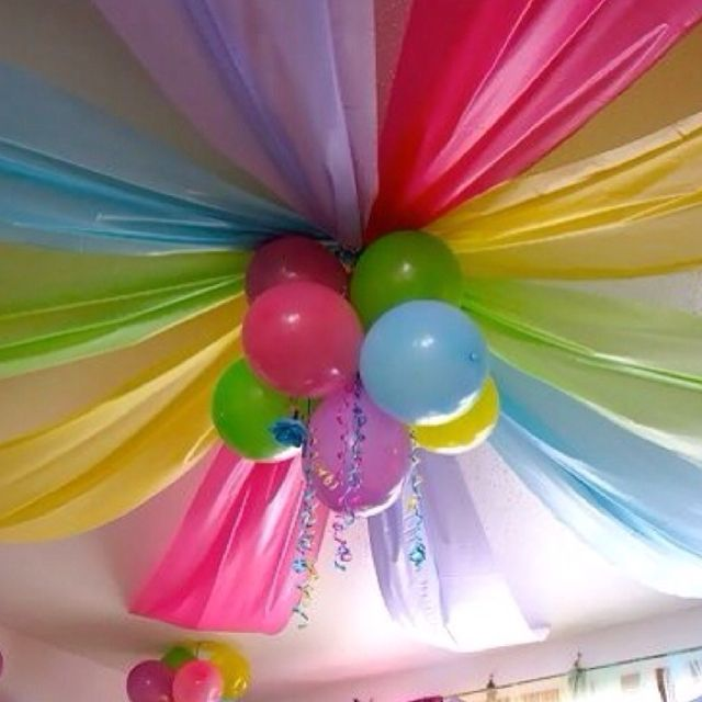 cheep table clothes and balloons above the platform or center of church