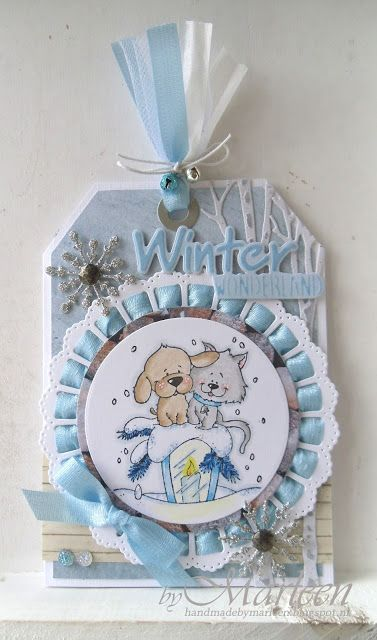 Handmade tag by DT member Marleen with Craftables Tiny's Trees Birch (CR1337), Winter Wonderland (CR1347), Ribbon Doily with Roset (CR1350) and Creatables Ice Crystals (LR0393) from Marianne Design: