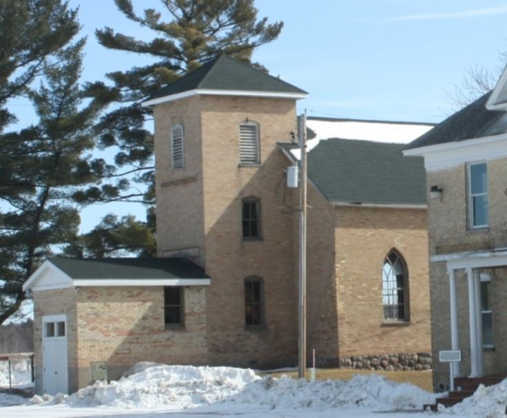The Mohican Indian Lutheran Church, with a school annex, was built in 1901 on a small lake now called Mission Lake. The dormitory next to the church was built in 1908. In about 1923, after a new dormitory was built, the two-story building next to the church became the school. The boarding school clo