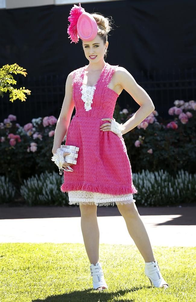 Oliver Lancini from Queensland, wearing a design by Tricia Mocachino. Picture: David Caird BOLD, colourful and fun has been the brief for the fashion flock at Flemington for the iconic Melbourne Cup.