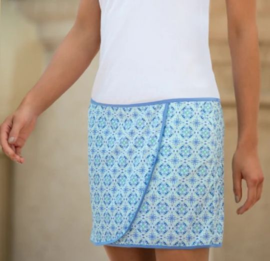 "Check out what #lorisgolfshoppe  has for your days on and off the golf course! Greg Norman Ladies & Plus Size Porcelain 18"" Knit Wrap Golf Skorts - BARCELONA (White)"