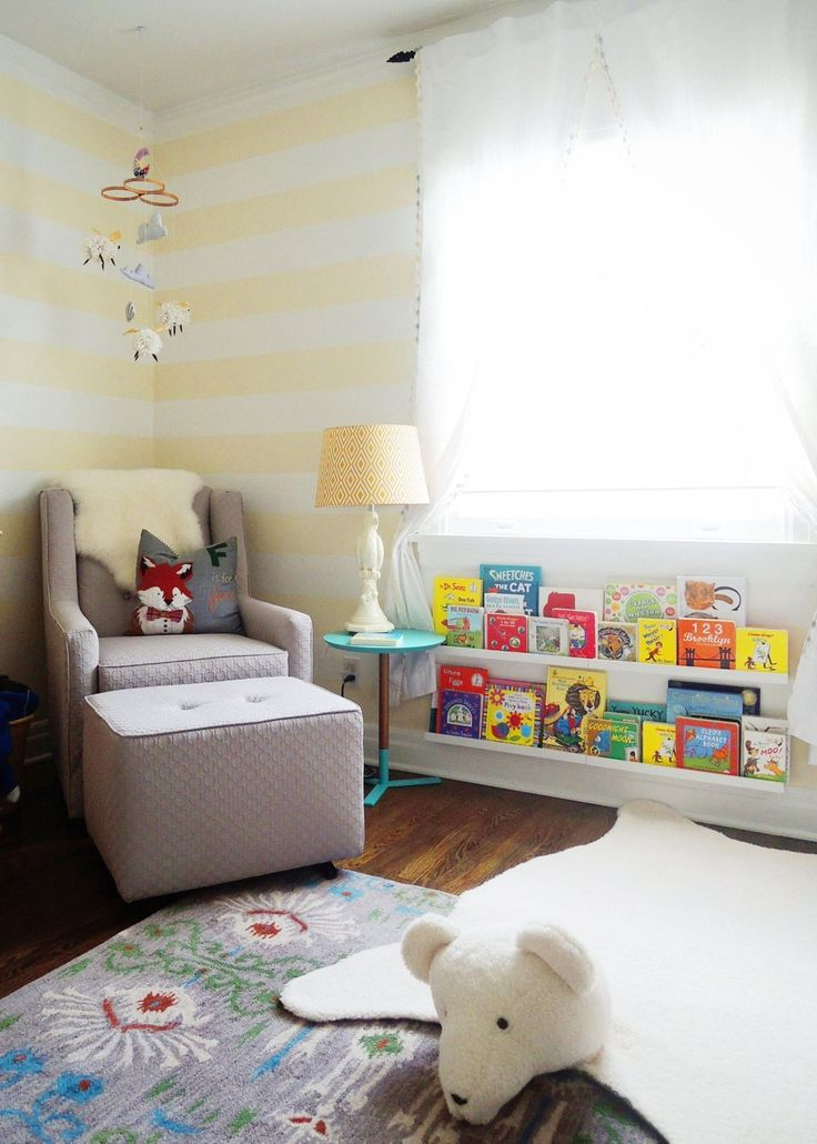 bookshelves under the window (would work except for the radiators) -- George's Magical Woodland Nursery