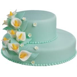 Lily Legend Cake. It's a striking contrast of colors, as white calla lilies ascend to the top of green fondant tiers. What a great feeling to know that your Gum Paste and Fondant Course experience makes amazing cakes like this possible