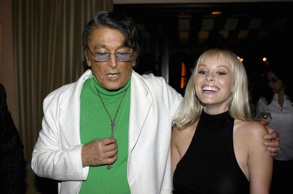 US TABS AND HOLLYWOOD REPORTER OUT Actor Robert Evans chats with actress Jaime Bergman at Comedy Central's celebration of Evans' upcoming animated...