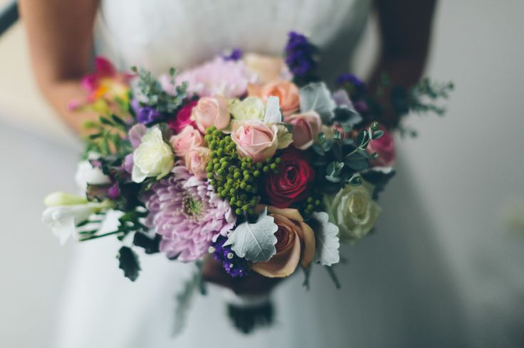Wedding theme bouquet of lush with a pop of colour, and a colour palette of apricots and pinks.   Lime Tree Bower