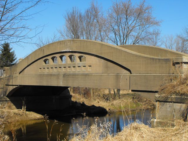 Grange Road Bridge, Over Stoney Creek, Clinton County, Michigan, 1923, By: Price Brothers Company of Lansing, Michigan and Michigan State Highway Department, This is a spectacular example of a concrete camelback bridge, in excellent condition.
