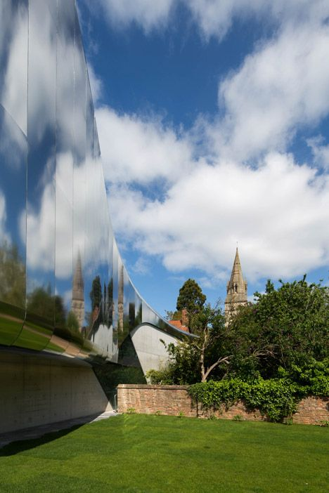 Zaha Hadid adds a shimmery steel tunnel to an Oxford University college.