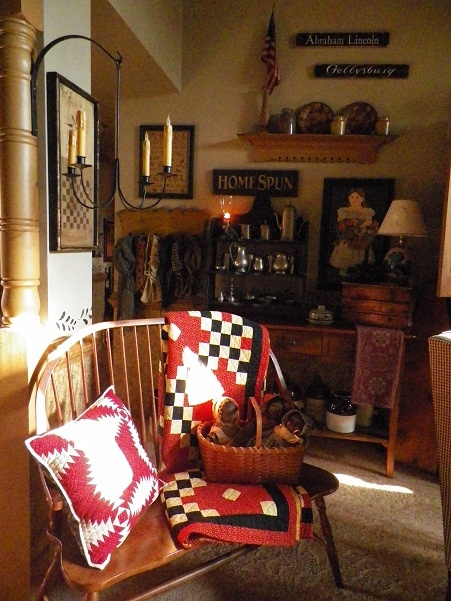 living room featuring a lovely quilt & quilted pillow-Joyce Reed's Home