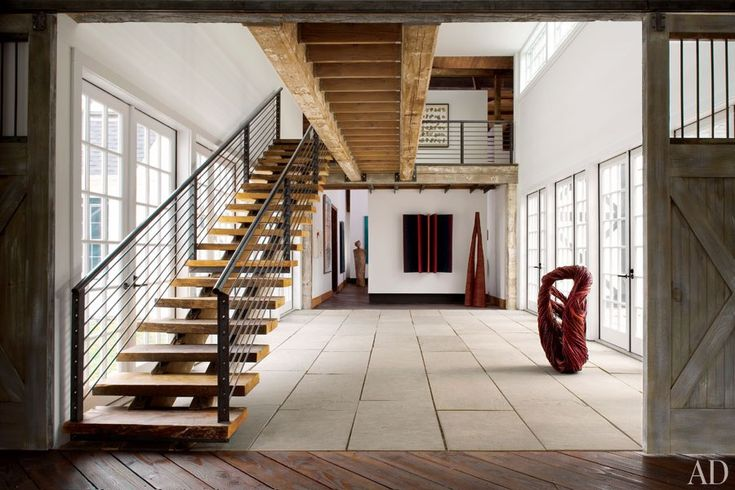 Rustic Barn-Style Homes: The entrance hall of an 1895 barn in Wilton, Connecticut, was restored and expanded by architect David Ling.