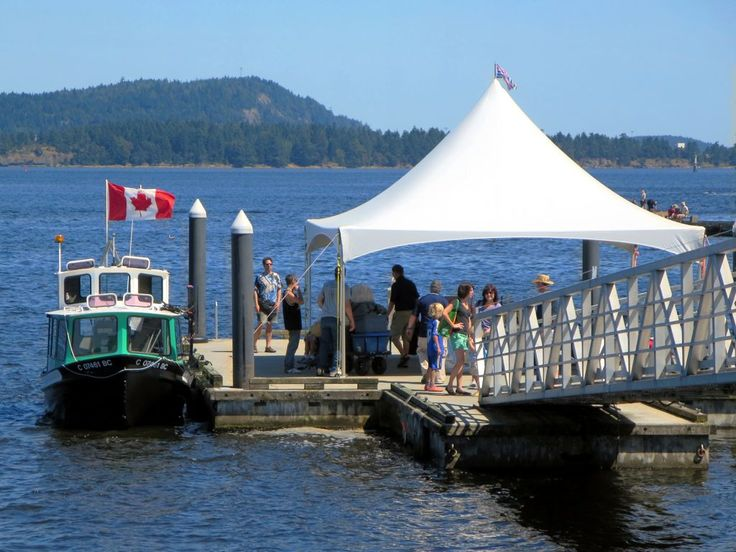 Passengers disembarking from the Newcastle Island Ferry at Maffeo Sutton Park in Nanaimo, British Columbia, Canada.