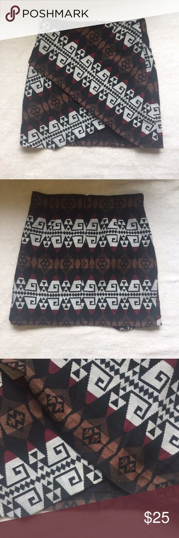 "Zara Aztec Print Skirt Size Small The material tag has been cut out so I am unsure of the material. Skirt has a wrap like feature but is not a wrap skirt please see pictures for better idea. Also I'm not sure if it how the skirt is made but the hem is not attached please see pictures.  Measurements:  Waist: 28""  Inseam: 17"" Zara Skirts"