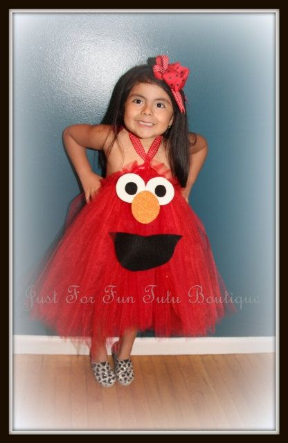 Thanks you for Visiting Just For Fun Tutu Boutique!    This cute Elmo costume is hand made with soft tulle, a red ribbon with white dots ties in