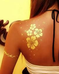 i want a gold tattoo... Maybe add one of these flowers to my infinity tattoo?