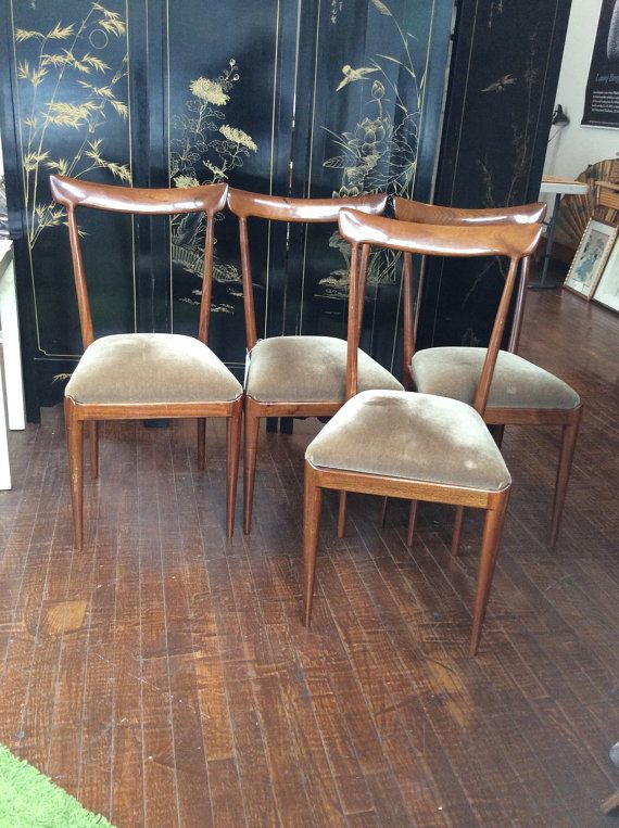 Beautifully classic set of dining room chairs. Perfect for any space-- bright, polished wood with a beige seat. Doe or fawn like silhouette. Good vintage condition with normal wear/small scratches. Small repair to one chair back, see pic. Additional photos and measurements available upon request.