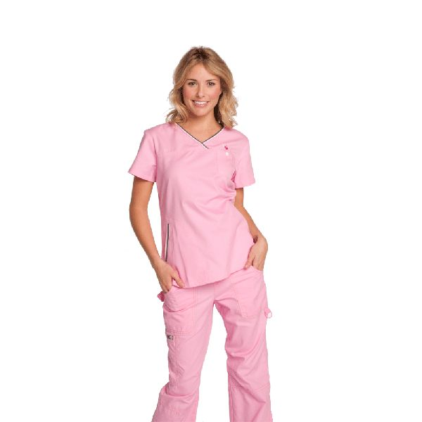Koi Ashley Top in Pink The Koi Ashley Top is part of the koi scrubs designer range. This scrub top has a simple yet flattering shape. There is a beautiful floral button and koi logo embroidered on the left hand side. The neckline is a stylish v-neck with a stripe trim. There are also two pockets and a chest pocket to hold all your belongings. This scrub top is lovely and soft and very comfy. £24.99  #nursescrubs #dentistscrubs #nurses #dentists #pinkscrubs #nurseuniform