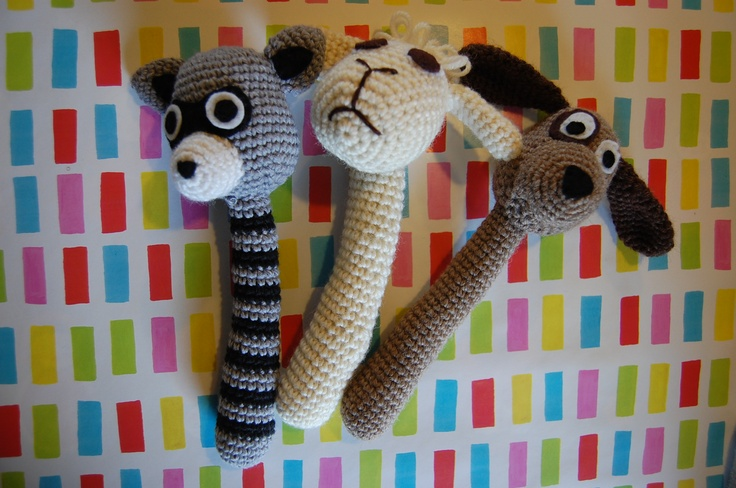 """Baby rattles. A racoon, a sheep and a dog.   Pattern from """"Flere hæklede dyr"""" by Maja Hansen (in Danish)"""