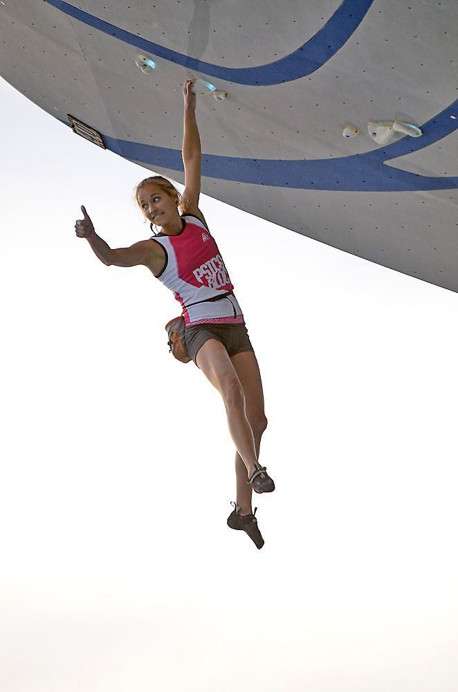 Sasha DiGiulian gives the thumbs up on her way to a win at Psicobloc.