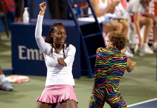 """Aug 5 Venus Williams dances with """"Spandy Andy"""" during an Opening Night Exhibition Doubles match at the Rogers Cup in Toronto on Monday. The Williams sisters played Eugenie Bouchard & Monica Seles."""