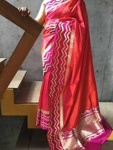 Orange banaras saree with pink border and small round buttas in blouse