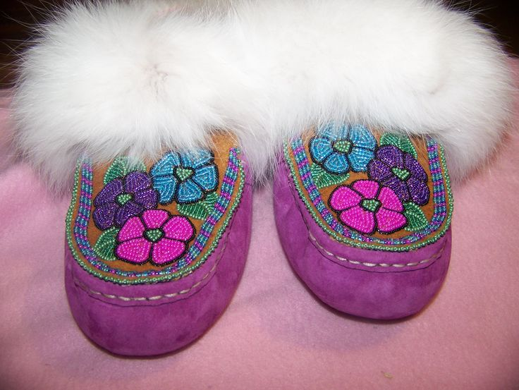Ugg Moccasin's with beaded moosehide tops trimmed with arctic fox fur. Alaska native beadwork by Liisia Carlo Edwardsen