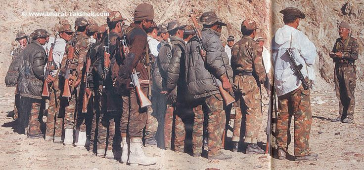 Jawans, armed with 5.56mm INSAS rifles, get their last minute orders at their base camp, before climbing up treacherous mountains to face the enemy.