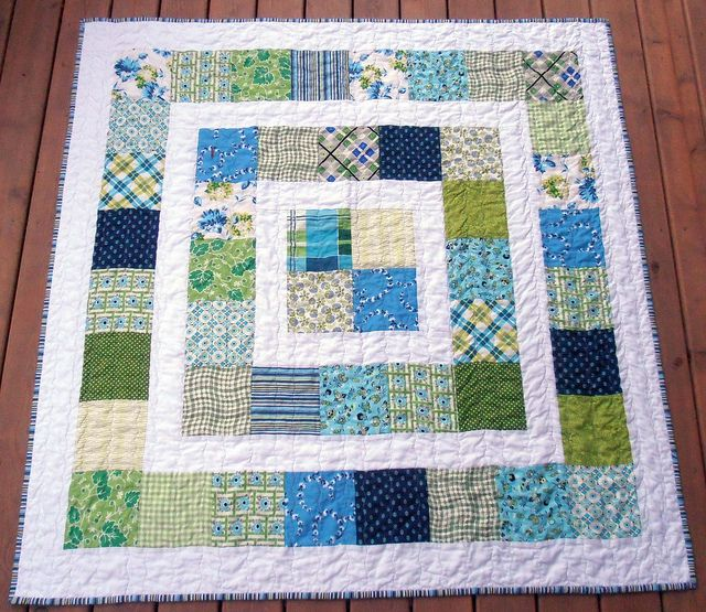 Easy quilt for a baby boy. or could work for girl as changing colors would be simple.