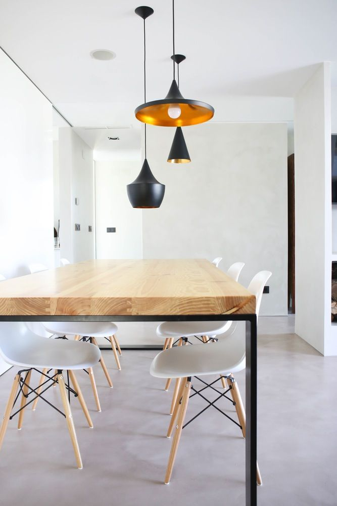A light & bright dining room with statement pendants