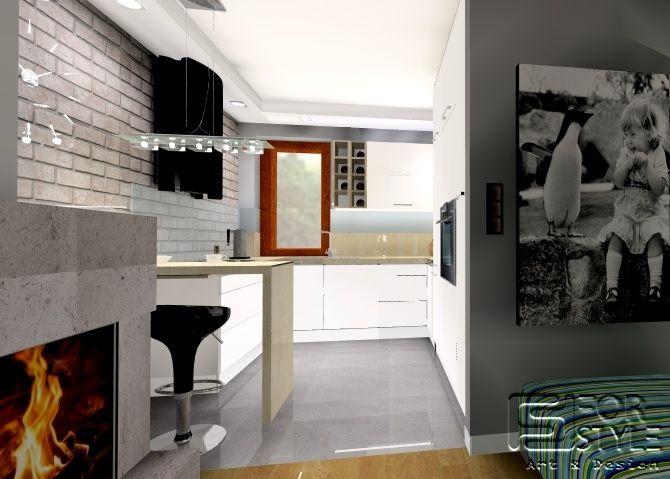 wejście do kuchni z salonu, kuchnia nowoczesna, biała z drewnianym blatem, kominek, nowoczesny panoramiczny, barek w kuchni i cegła na ścianie ...Projektowanie wnętrz 4-style.pl
