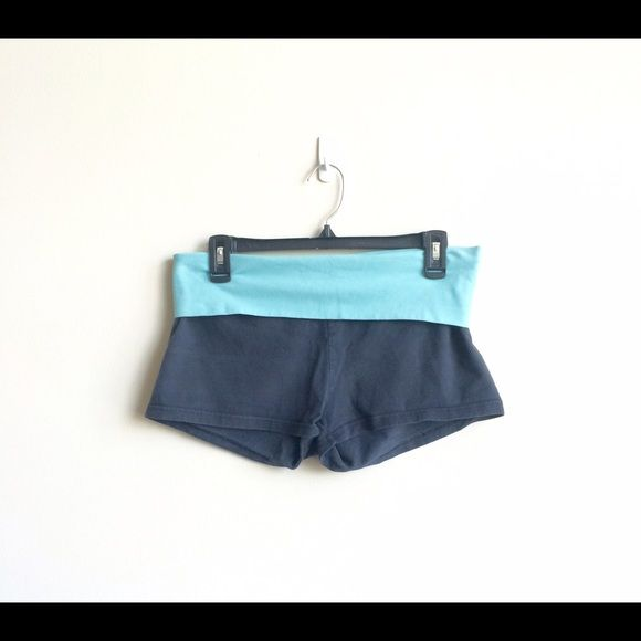 Aerie slim gym shorts This pair of Aerie slim gym shorts are a must have for anyone into fitness. The shorts are slim fitting and are perfect for any activity where loose clothing could cause injury. This pair is dark blue, with a lighter blue fold over waist. They are a size large, show little wear and are free from rips, tears and stains.  I'm only selling these and reasonable offers are always welcome. Bundle and save on shipping! aerie Shorts