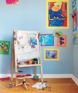 Use colorful tape to frame kids' artwork. Won't hurt walls. No nail